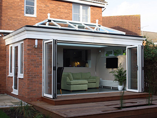 modern conservatory with bifold doors open